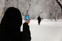 Woman taking picture with camera. Moscow. Russia. Royalty Free Stock Photo