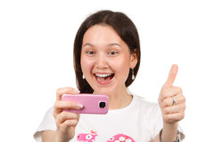 Woman taking a picture by cameraphone Stock Images
