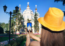 Woman taking picture of Church by phone Stock Photography