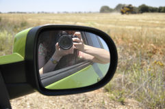 Woman taking a picture of a combine harvester Stock Images