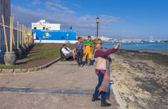 Woman taking a picture in Corralejo Royalty Free Stock Photo