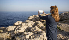 Woman taking picture with a digital tablet camera Stock Photo
