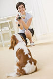 Woman Taking Picture of Dog Stock Image