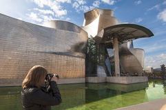 Woman taking a picture at the Guggenheim Stock Photos