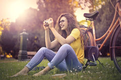 Woman taking a picture Stock Photo