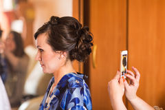Woman taking picture of her girlfriend hairstyle Royalty Free Stock Photo