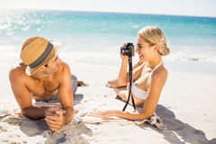 Woman taking picture of her man Stock Image