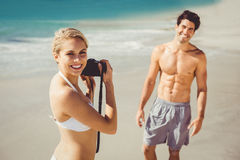 Woman taking picture of her man royalty free stock photos