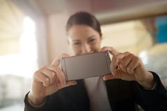 Woman taking a picture with her mobile Stock Photography