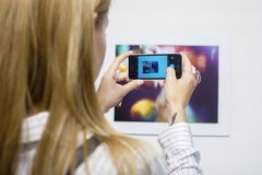 Taking pictures on a photo exhibition royalty free stock photo