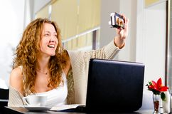 Woman is taking a picture of herself Stock Photo