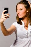 Woman is taking picture of herself Royalty Free Stock Photos