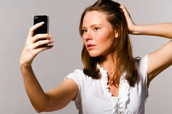 Woman is taking picture of herself Stock Image