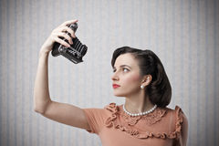 Woman taking a picture of herself Royalty Free Stock Photo