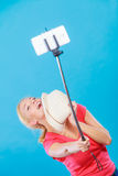 Woman taking picture of herself with phone on stick Royalty Free Stock Photo