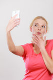 Woman taking picture of herself with phone Royalty Free Stock Image