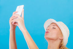 Woman taking picture of herself with phone Stock Photos