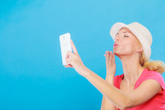 Woman taking picture of herself with phone Royalty Free Stock Photo