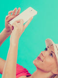 Woman taking picture of herself with phone Royalty Free Stock Images