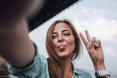 Woman taking picture of herself, selfie Royalty Free Stock Images