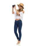 Woman Taking A Picture Isolated stock photo