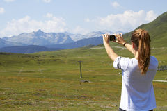Woman taking a picture of the landscape Stock Image