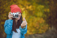 Woman is taking picture of a leaf stock photo