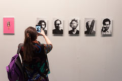 Woman taking a picture at Miart 2014 in Milan Royalty Free Stock Photography