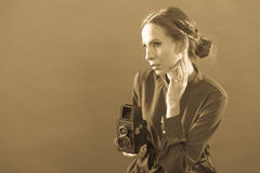 Woman taking picture with old camera Stock Photography