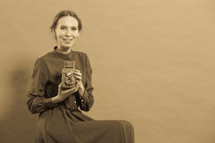 Woman taking picture with old camera Stock Photos