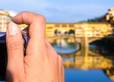 Woman taking picture of the Ponte Vecchio in Florence Royalty Free Stock Photo