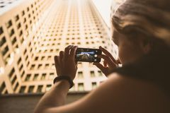 Woman Taking Picture Using Smartphone During Daytime Royalty Free Stock Images
