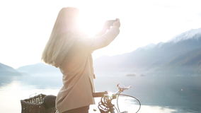 Woman taking a picture using a smartphone stock footage