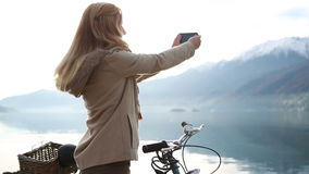 Woman taking a picture using a smartphone stock video footage
