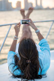 Woman taking picture on a yacht Stock Photo