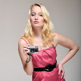 Woman taking a picture. Young caucasian woman dressed in pink, taking a picture while in fashion pose Royalty Free Stock Photo