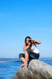 Woman taking pictures. Front view of young caucasian woman photographer taking pictures on a beach royalty free stock photos
