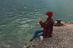 Woman taking pictures with a cellphone. Beautiful woman enjoying her day taking pictures with her phone Stock Photography
