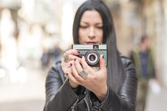 Woman taking pictures with classica camera. Stock Photography