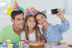 Woman taking pictures of her family during a birthday party Royalty Free Stock Photos