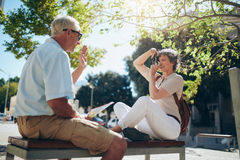 Woman taking pictures of her husband Royalty Free Stock Photos