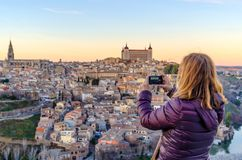 Woman taking pictures with her mobile phone in Toledo stock photos