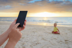 Woman is taking pictures of her son Stock Images