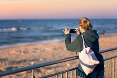 Woman taking pictures on holidays royalty free stock photos