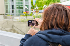 Woman Taking Pictures with a Mobile Phone Royalty Free Stock Photography