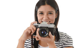 Woman taking pictures posing smiling happy using cool retro and vintage photo camera Royalty Free Stock Photography