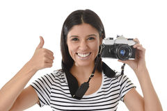 Woman taking pictures posing smiling happy using cool retro and vintage photo camera Stock Photography