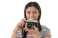 Woman taking pictures posing smiling happy using cool retro and vintage photo camera Royalty Free Stock Images