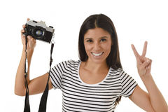 Woman taking pictures posing smiling happy using cool retro and vintage photo camera Stock Image