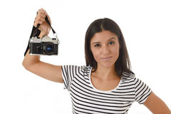 Woman taking pictures posing smiling happy using cool retro and vintage photo camera Stock Photos